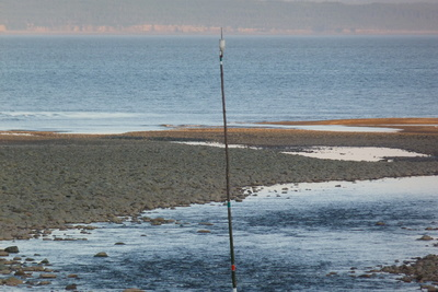 low tide and navigation pole